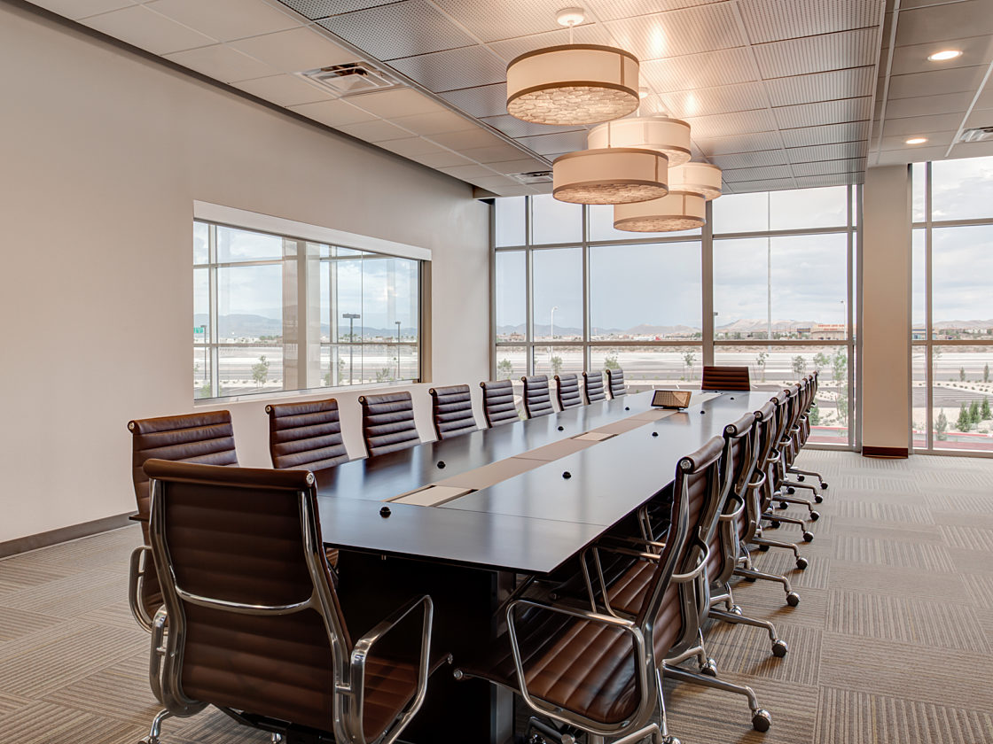 Long conference room table with Eames chairs in Las Vegas office