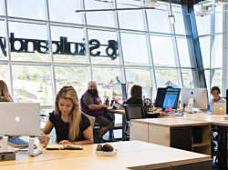 Skullcandy employees enjoying their new office design in Park City headquarters